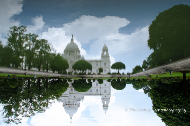 Victoria memorial reflected in the pond.